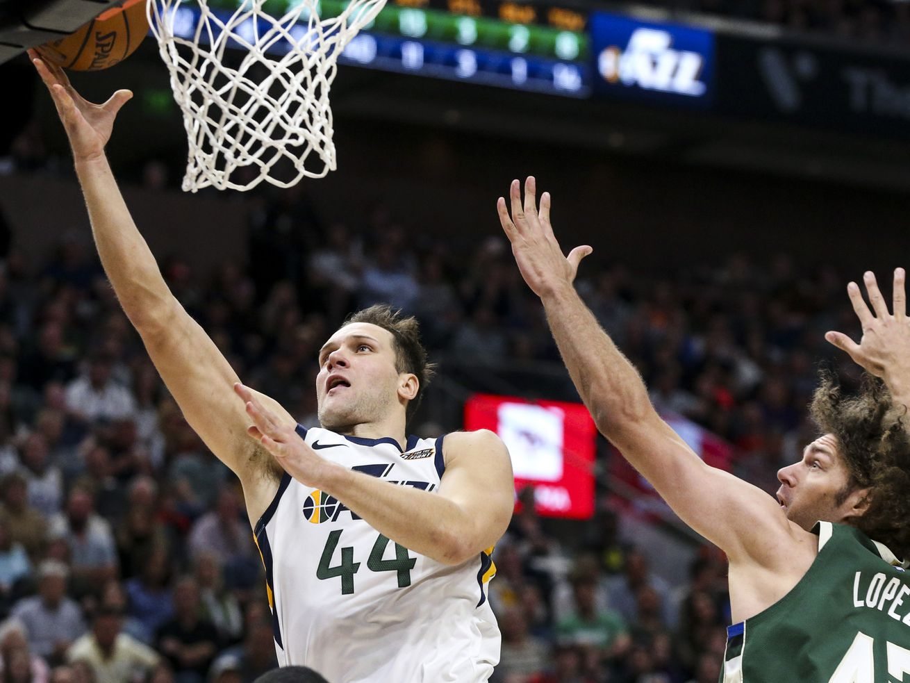 Utah Jazz forward Bojan Bogdanovic (44) goes for a layup over Milwaukee Bucks center Robin Lopez (42) during the second half of an NBA basketball game at Vivint Arena in Salt Lake City on Friday, Nov. 8, 2019.