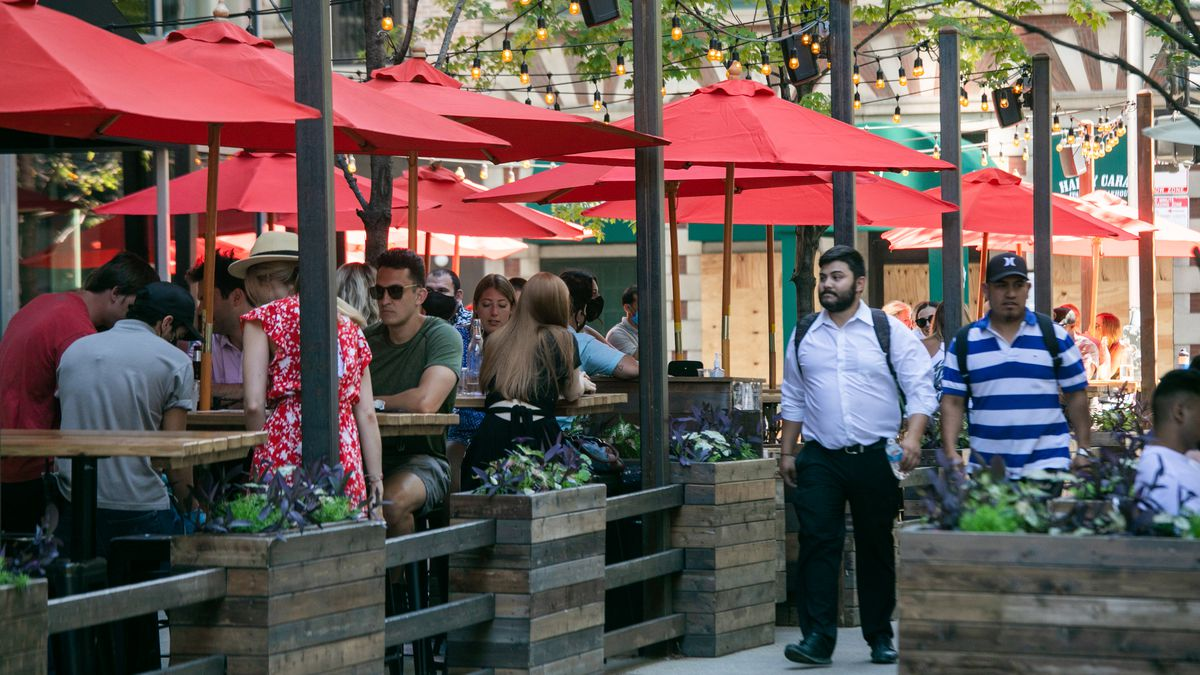 People dine at Parlor Pizza Bar in River North on July 3, 2020.
