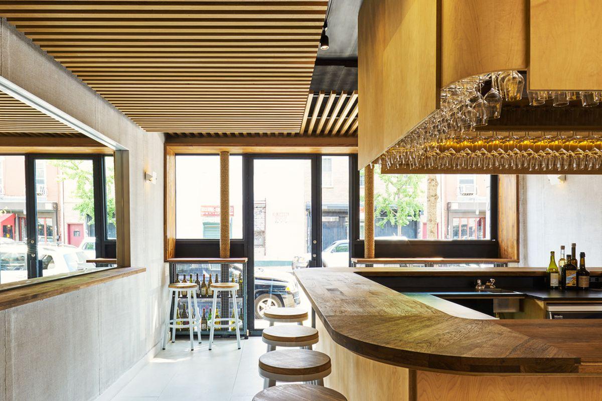 The blonde wood bar at Four Horsemen
