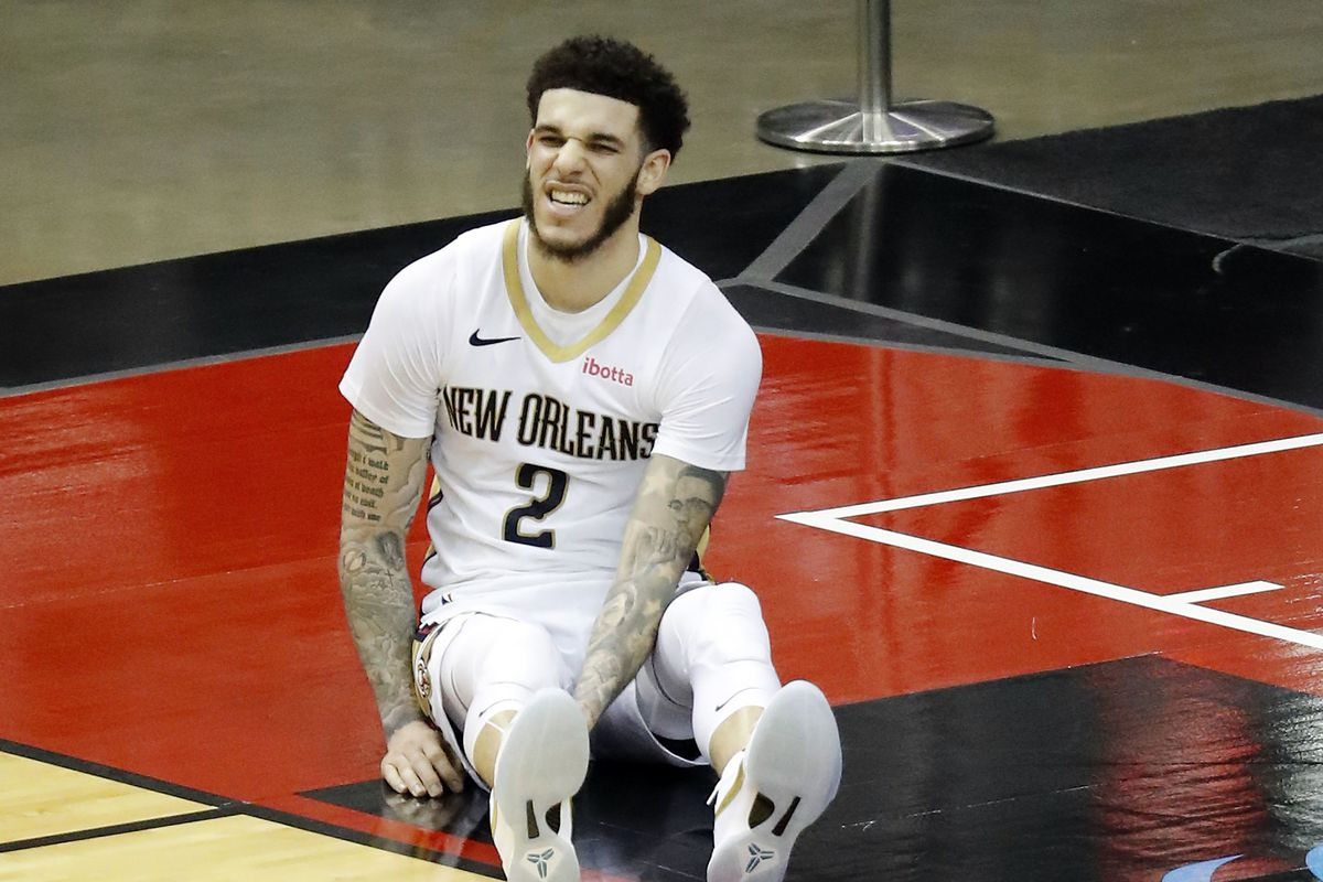 New Orleans Pelicans guard Lonzo Ball sits on the floor during the fourth quarter against the Houston Rockets at Toyota Center.