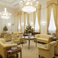 A view of the celestial room of the Mesa Arizona Temple. Lustrous crystalline chandeliers highlight the neoclassical motif with fluted pilasters and Corinthian capitals, which are offset by crystalline sconces. These, combined with exquisite hand-crafted furnishings, are designed to uplift the spirit and inspire the soul. Entering this sacred space represents the ultimate progression one can achieve: into heaven itself.