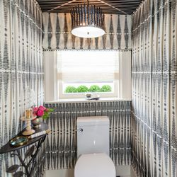 """Often times we feel bad for designers who are stuck with teeny tiny spaces. Designer <a href=""""http://www.kelleyflynn.com/"""">Kelley Flynn</a> showed us that size does not matter when it comes to producing good design. She turned this water closet into a hal"""