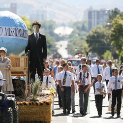 A float and people dressed as missionaries take part in The Days of '47 Youth Parade on 500 South in Salt Lake City on Saturday, July 23, 2016.