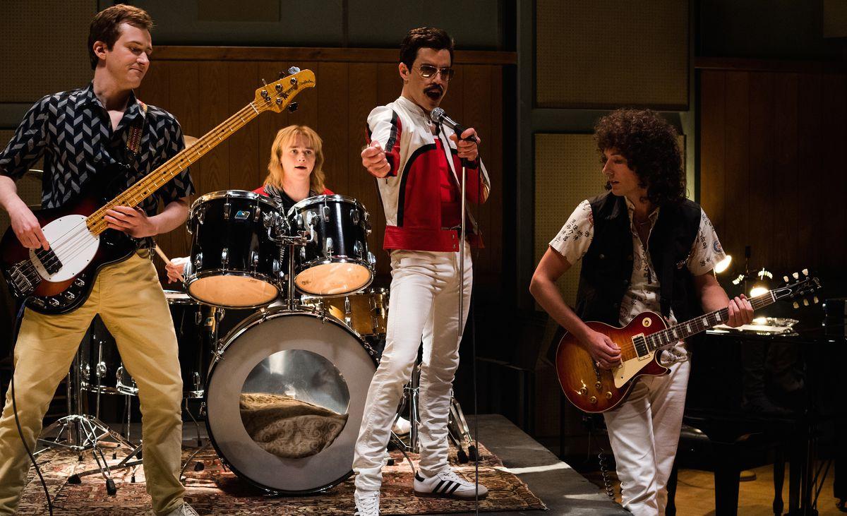 Rami Malek, Ben Hardy, Joe Mazzello, and Gwilym Lee as Queen in Bohemian Rhapsody.