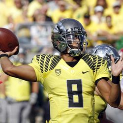 Oregon quarterback Marus Mariota prepares to throw during the first half of an NCAA college football game against Fresno State in Eugene, Ore., Saturday, Sept. 8, 2012.