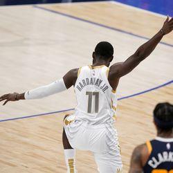 Dallas Mavericks forward Tim Hardaway Jr. (11) celebrates sinking a three-point basket in front of Utah Jazz guard Jordan Clarkson (00) in the second half of an NBA basketball game in Dallas, Monday April 5, 2021.