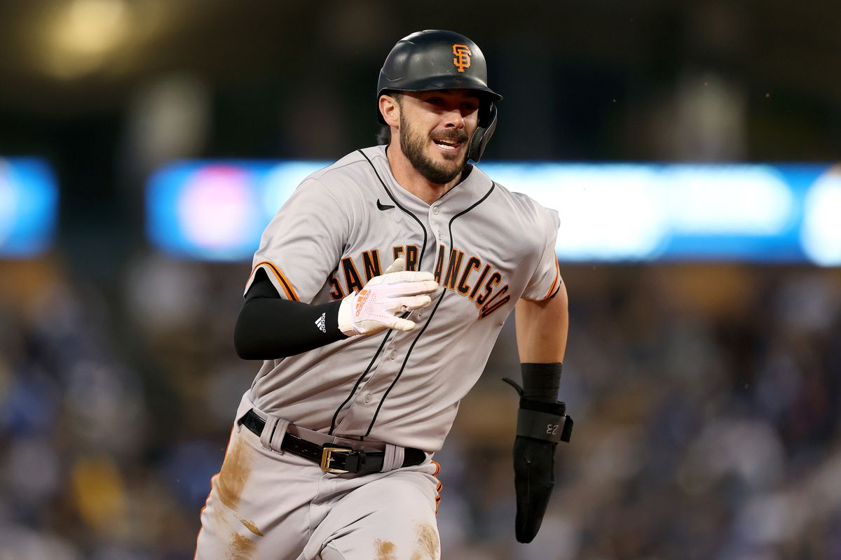 Kris Bryant #23 of the San Francisco Giants runs to third base against the Los Angeles Dodgers second inning in game 4 of the National League Division Series at Dodger Stadium on October 12, 2021 in Los Angeles, California.