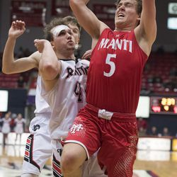 Manti High School senior Matt Nelson shoots a basket through the South Sevier defense during the Class 3A boys championship game at Dixie State University Saturday, February 24, 2018.