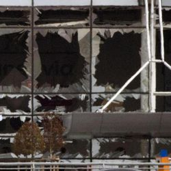 The blown out windows of Zaventem airport are seen after a deadly attack in Brussels, Belgium, Tuesday, March 22, 2016. Authorities in Europe have tightened security at airports, on subways, at the borders and on city streets after deadly attacks Tuesday on the Brussels airport and its subway system.