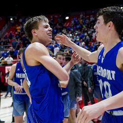 Fremont's Dallin Hall and Baylor Harrop celebrate their win over Davis in the 6A boys basketball championship game at the Huntsman Center in Salt Lake City on Saturday, Feb. 29, 2020.