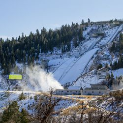 Snow machines blow man-made snow near the bottom of the ski jumps at the Utah Olympic Park near Park City on Monday, Nov. 30, 2020.
