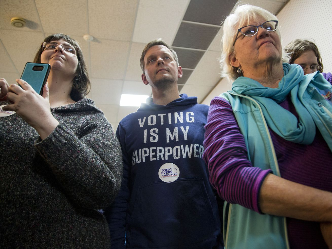 Wisconsin voters listen to now-Gov. Tony Evers during his 2018 race.