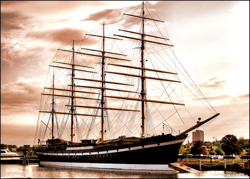 The Moshulu ship in Philadelphia. There are multiple masts and the ship is black.