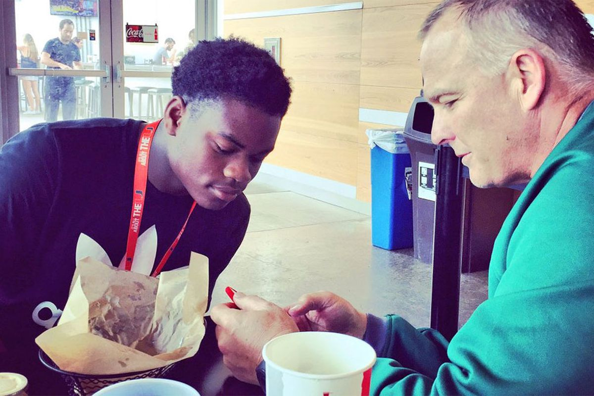 DeeJay Dallas and Mark Richt speak while on Dallas' official visit