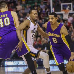 Utah Jazz guard George Hill (3) attempts to guard Los Angeles Lakers guard Jordan Clarkson (6) while he drives to the basket during the second half at the Vivint Smart Home Arena in Salt Lake City on Thursday, Jan. 26, 2017. The Jazz went on to win, 96-88.