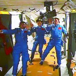 Chinese astronauts, from left, Liu Wang, Liu Yang and Jing Haipeng wave while aboard the orbiting Tiangong-1 space station.   Beijing Aerospace Control Center/Xinhua via AP file