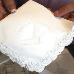 Amy Bailey holds a handkerchief Monday that will be put in a time capsule for the Oquirrh Mountain Temple.