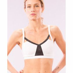 """Our pick: <i>Sport</i> this bra on its own or underneath a mesh top for a peekaboo look. V-neck bra with leather detail, $73 at <a href=""""http://solowstyle.com/p-4681-v-neck-bra-with-leather-detail.aspx#.Us95fGRDtrV"""">Solow</a>"""