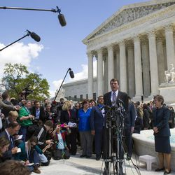 Washington attorney Douglas Hallward-Driemeier, speaks with reporters outside the Supreme Court in Washington, Tuesday, April 28, 2015, after arguing arguing that states must recognize same-sex marriages performed elsewhere before the court