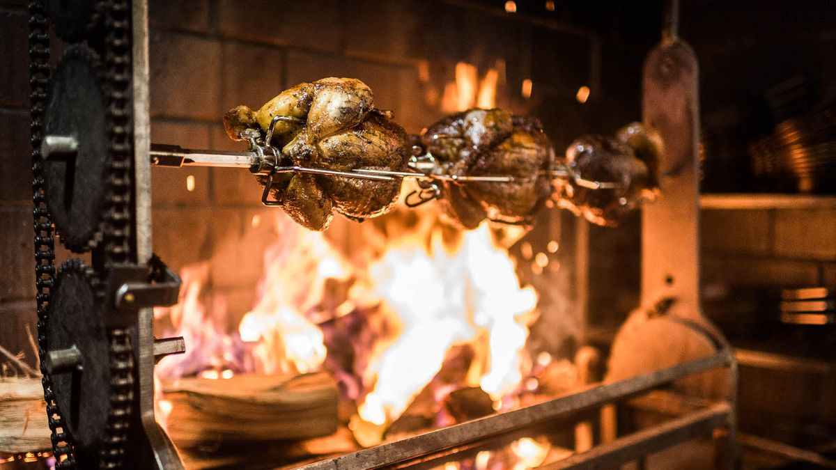 Chickens roasting over the wood fire at A Rake's Progress