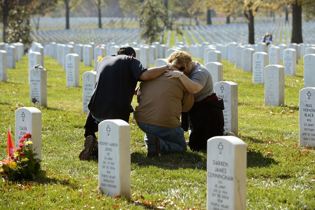 Mourners in Arlington Cemetery. A parents' death can place student loan borrowers in default.
