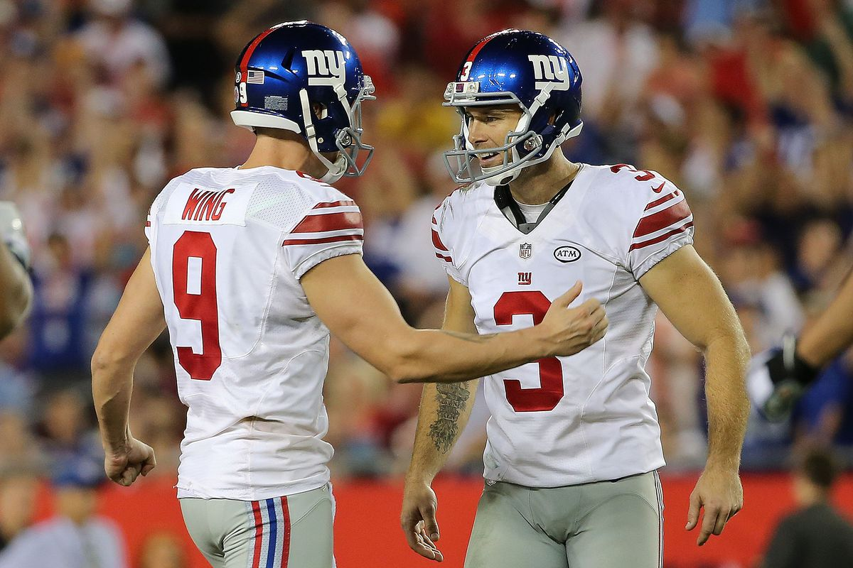 Josh Brown (right) and Brad Wing celebrate a field goal vs. the Buccaneers