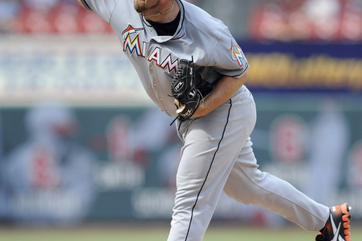July 8, 2012; St. Louis, MO. USA; Miami Marlins relief pitcher Heath Bell (21) throws to a St. Louis Cardinals batter in the ninth inning at Busch Stadium. Bell blew the save and the Cardinals won 5-4. Mandatory Credit: Jeff Curry-US PRESSWIRE