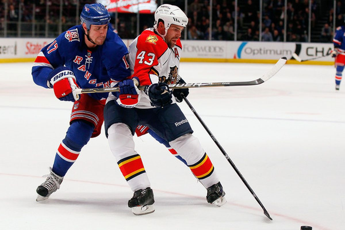 NEW YORK - MARCH 22:  Mike Weaver #43 of the Florida Panthers controls the puck in front of Brandon Dubinsky #17 of the New York Rangers on March 22, 2011 at Madison Square Garden in New York City, New York.  (Photo by Mike Stobe/Getty Images)