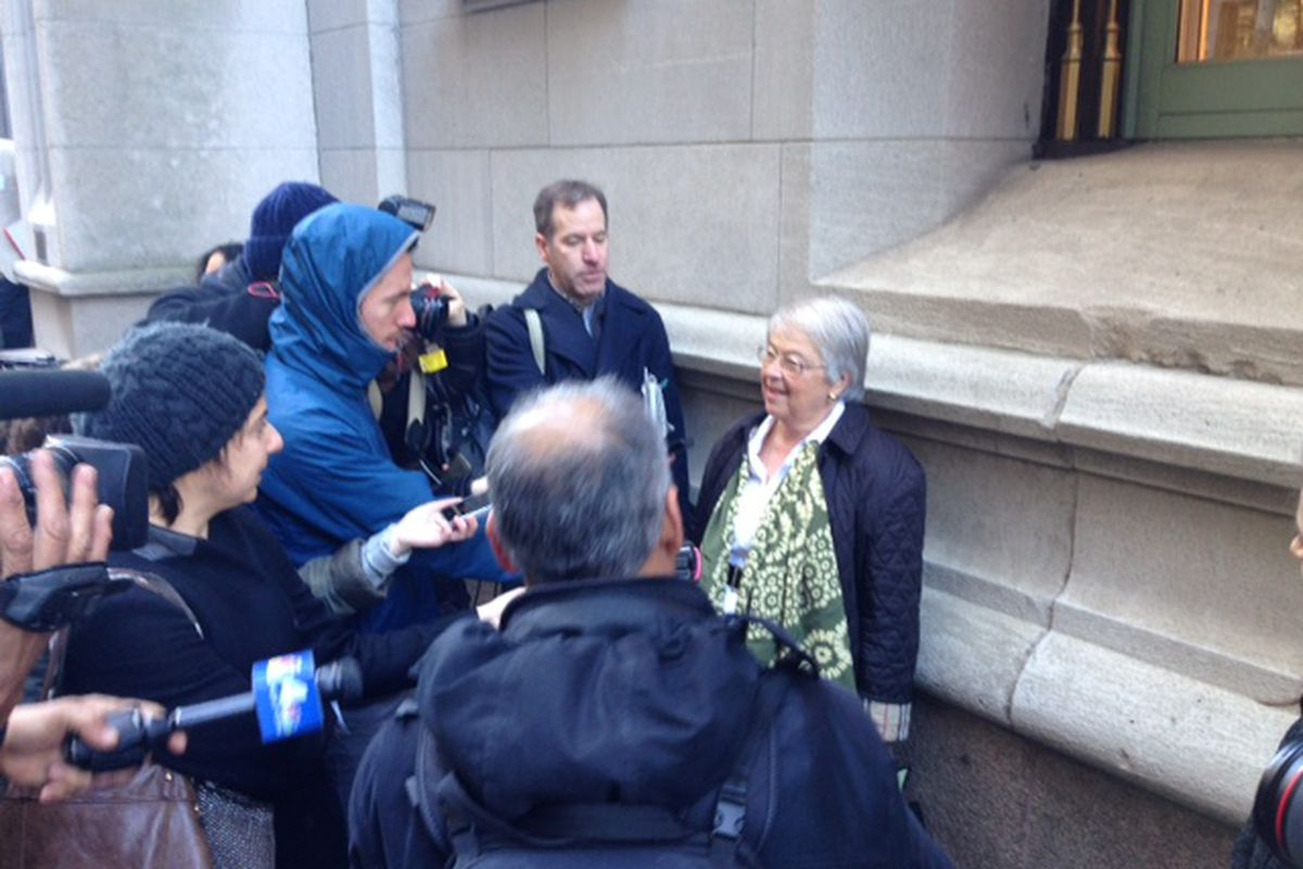 A larger press scrum than normal questions Chancellor Fariña after leaving a meeting with charter school leaders.