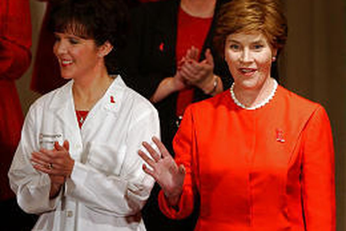First lady Laura Bush, right, waves to crowd at St. Luke's Hospital while standing next to Dr. Tracy Stevens.