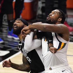 Los Angeles Clippers forward Marcus Morris Sr., left, and Utah Jazz center Derrick Favors battle for a rebound during the second half of Game 3 of a second-round NBA basketball playoff series Saturday, June 12, 2021, in Los Angeles.