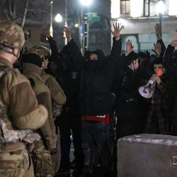 Protesters confront members of the Wisconsin National Guard near the Kenosha County Courthouse after District Attorney Michael Graveley announced that no charges will be filed against the Kenosha police officer who shot Jacob Blake, Tuesday night, Jan. 5, 2021.