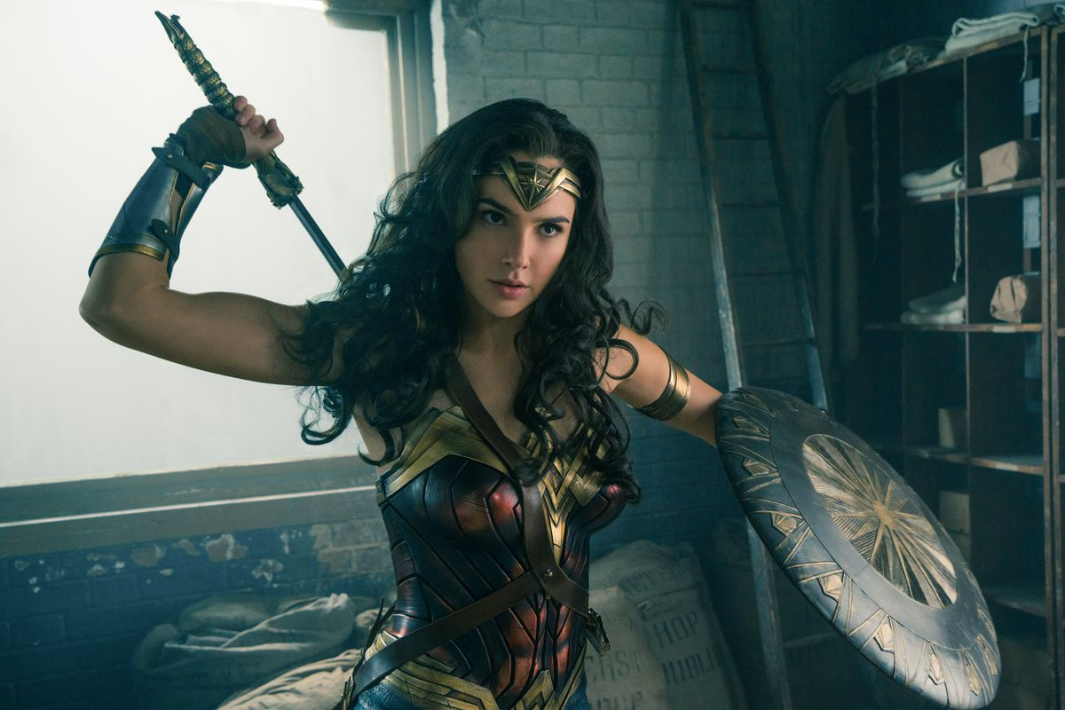 Wonder Woman pulling out her sword