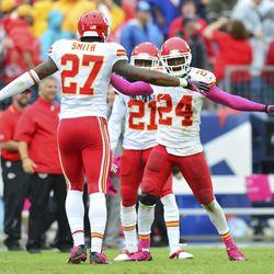 Oct 6, 2013; Nashville, TN, USA; Kansas City Chiefs cornerback Sean Smith (27) and cornerback Brandon Flowers (24) celebrate a win over the Tennessee Titans at LP Field. The Chiefs beat the Titans 26-17.