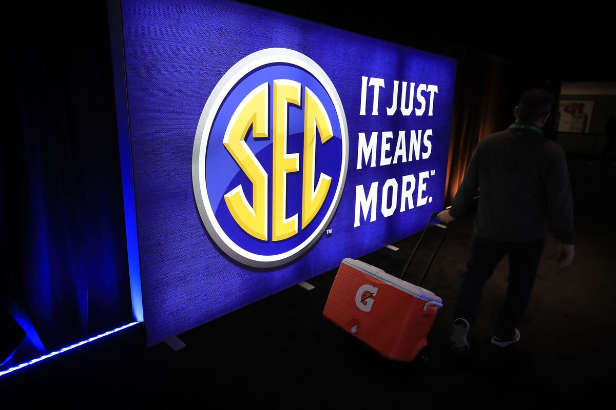 A worker takes a cooler off of the court after the announcement of the cancellation of the SEC Basketball Tournament at Bridgestone Arena on March 12, 2020 in Nashville, Tennessee. The tournament has been cancelled due to the growing concern about the spread of the Coronavirus (COVID-19).
