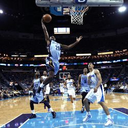 Memphis Grizzlies forward Quincy Pondexter (20) drives to the basket in front of New Orleans Hornets forward Gustavo Ayon (15) during the first half of an NBA basketball game in New Orleans, Sunday, April 15, 2012.