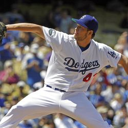 Los Angeles Dodgers starter Clayton Kershaw pitches to the San Diego Padres in the second inning of a baseball game in Los Angeles, Sunday, April 15, 2012.  (AP Photo/Reed Saxon)