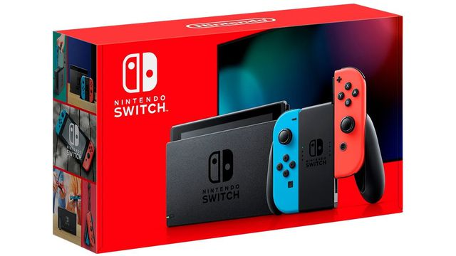 Photo of the packaging for the revised Nintendo Switch model, showing a docked Switch and controller in front of a television, with a red background