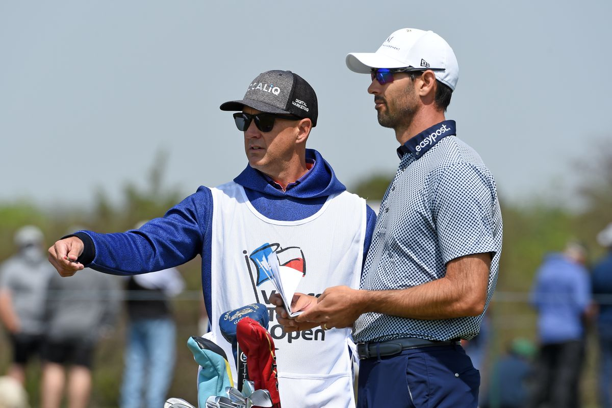 Cameron Tringale talks with his caddie on the third hole during the second round of Valero Texas Open at TPC San Antonio Oaks Course on April 02, 2021 in San Antonio, Texas.