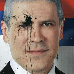 FILE -  Jan. 27, 2008 file photo of a pre-election poster of Serbia's President Boris Tadic splattered with  paint, in Belgrade, Serbia.  Tadic said Wednesday April 4 2011 that he is resigning, paving the way for an early presidential election where he will face a strong challenge from a nationalist candidate. In the presidential vote, Tadic will be challenged by nationalist candidate Tomislav Nikolic who has received tacit support from Russia.