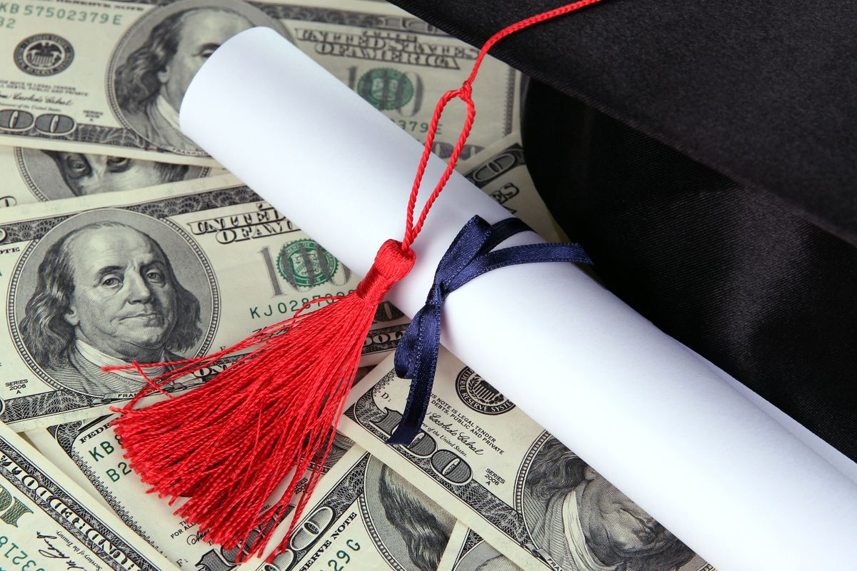 Mortarboard with money and diploma