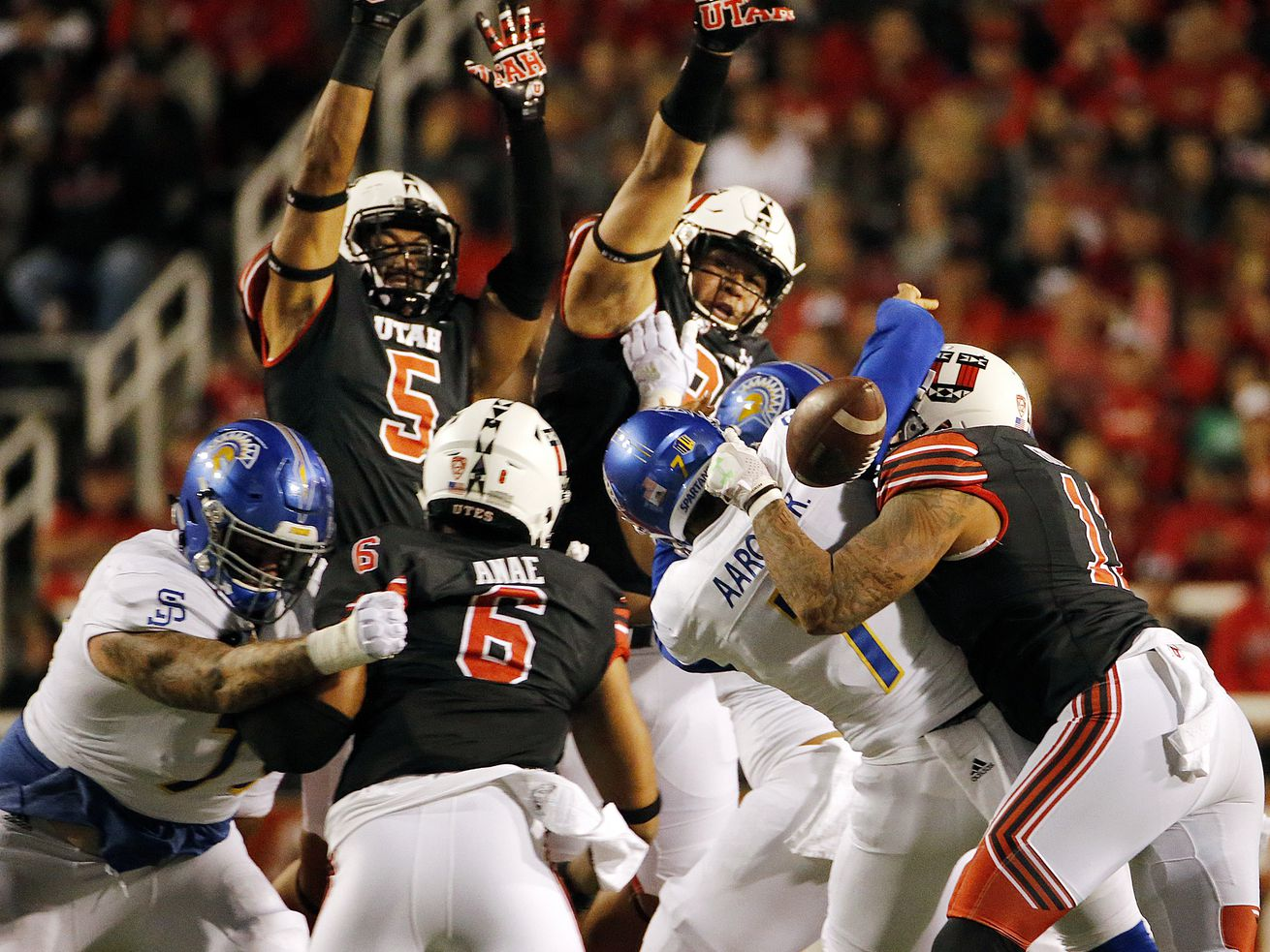 San Jose State Spartans quarterback Montel Aaron fumbles the ball as he is hit by Utah Utes defensive end Kylie Fitts during NCAA football played in Salt Lake City on Saturday, Sept. 16, 2017.