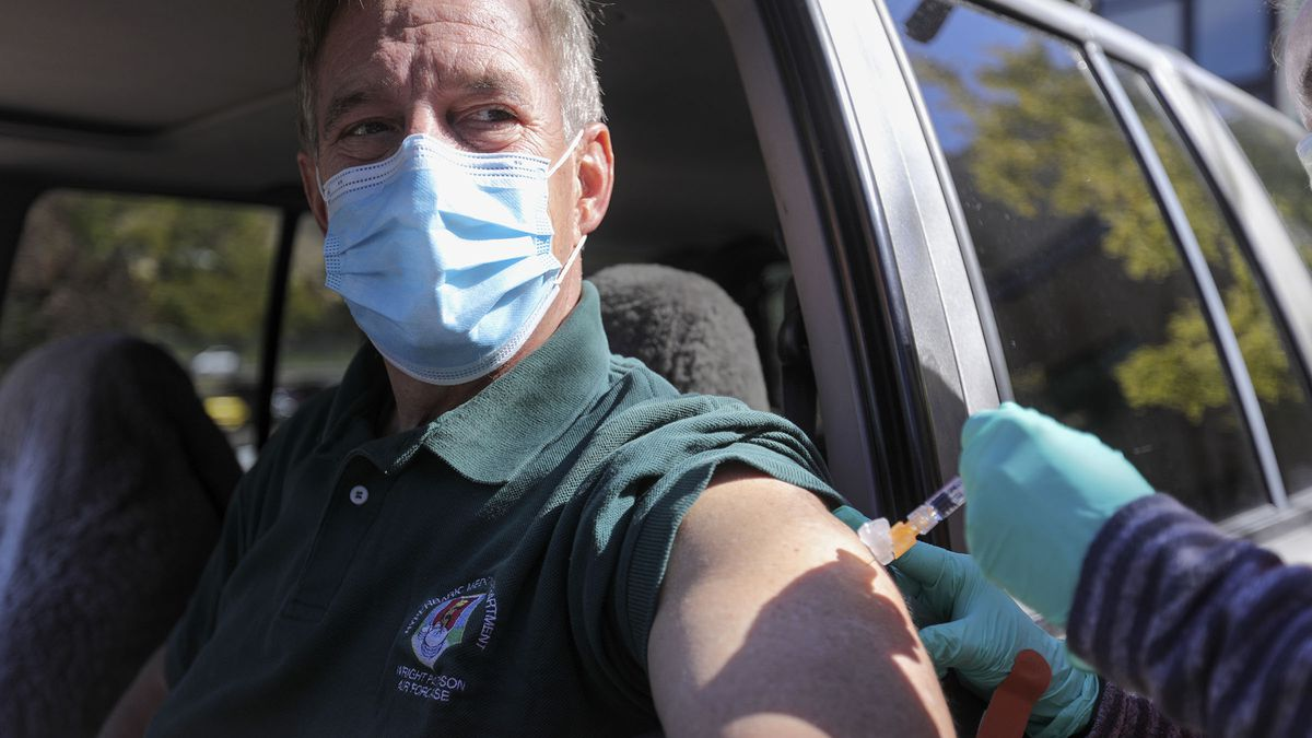 Richard Villata, Air Force reserves flight doctor, gets a flu shot at a drive-thru flu vaccine clinic for veterans at the George E. Whalen Department of Veteran Affairs Medical Center in Salt Lake City on Tuesday, Oct. 13, 2020. The clinic is available for veterans Monday to Friday from 8 a.m. to 4:30 p.m.