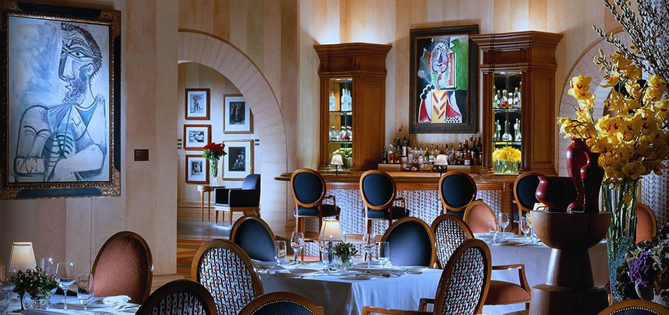 A dining room with paintings from Picasso