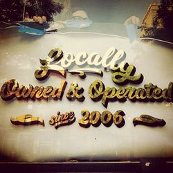 """<span class=""""credit"""">Detail of the gold leaf sign by Best Dressed Signs via <a href=""""https://www.facebook.com/photo.php?fbid=519377954798311&set=a.231564563579653.53326.231169830285793&type=1&theater"""">Orchard Skateshop</a>/Facebook</span><p>"""