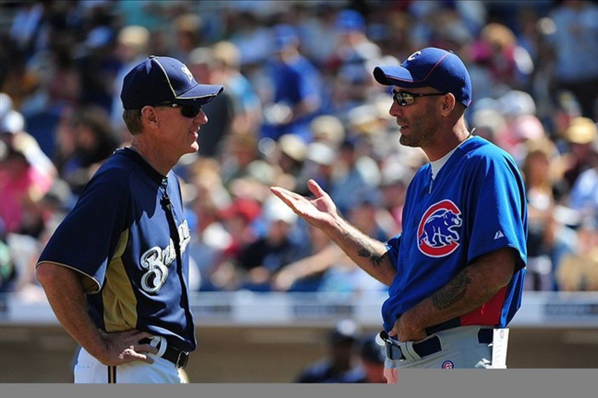 Chicago Cubs manager Dale Sveum talks to Milwaukee Brewers manager Ron Roenicke before the game at Maryvale Baseball Park.  Credit: Kyle Terada-US PRESSWIRE