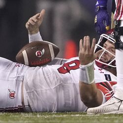 Utah quarterback Jake Bentley reacts after being sacked during the second half of the team's NCAA college football game against Washington, Saturday, Nov. 28, 2020, in Seattle. Washington won 24-21.