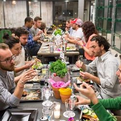 """The first """"Made in DC"""" dinner hosted by Union Kitchen took place on Tuesday at WeWork DC's coworking space, inside the Wonder Bread Factory in Shaw."""