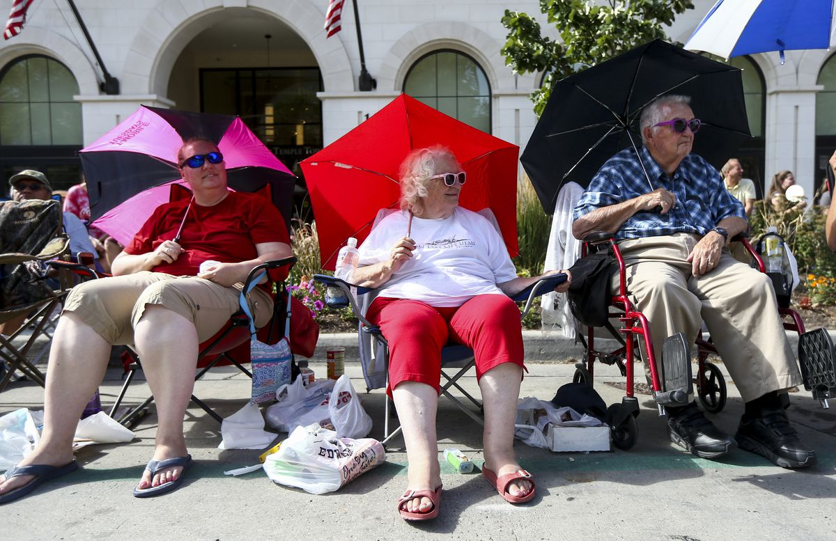 Annjanette Kemp, left, Ora Hegerhorst and Walt Hegerhorst watch a marching band pass by during the Days of '47 Parade in Salt Lake City on July 24, 2019. Ora Hegerhorst has been attending the parade for over 50 years.