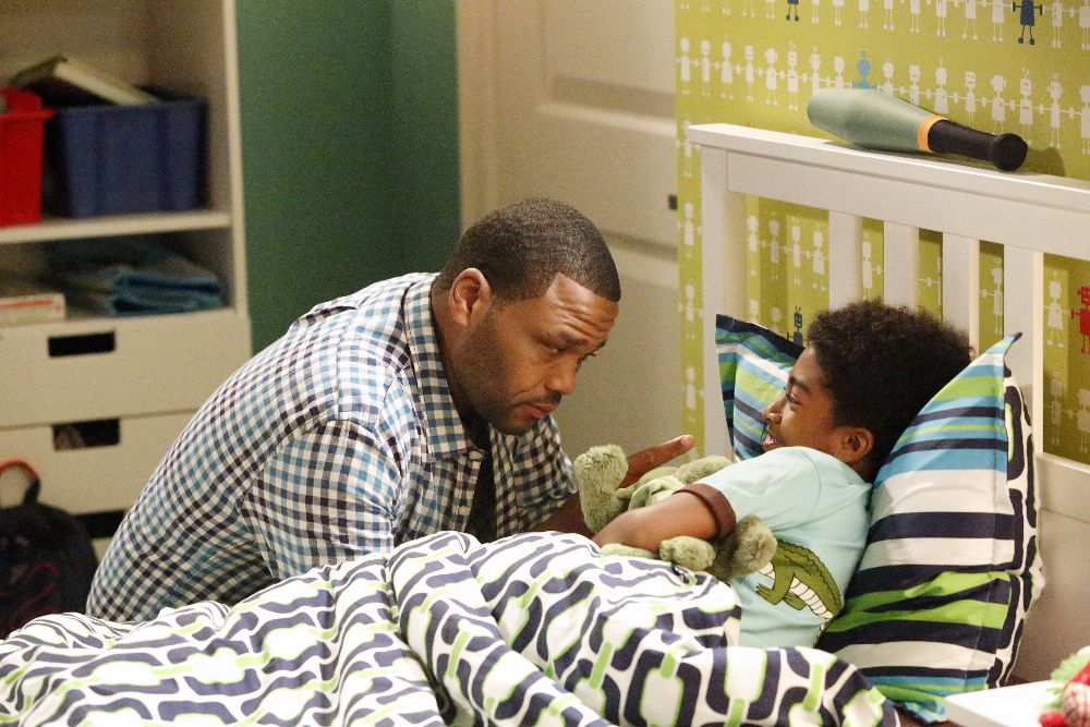 Dre and his son on black-ish.